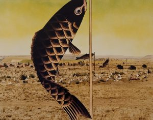 A collaged photograph depicting a brown, rocky landscape and small, white crosses, with a green-and-yellow sky is bisected by a thin, vertical rod and an illustration of a black-and-brown twisting fish hanging from the rod.