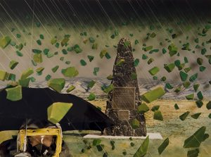 A collaged photograph showing a pyramid-shaped monument made of dark rock in the center of the composition with a mountain in the distant background. Angled, thin, white lines and green, stone forms appear to be raining down from the sky. In the foreground, a man, seen from the neck up, holds a black umbrella and wears a yellow radiation hood.